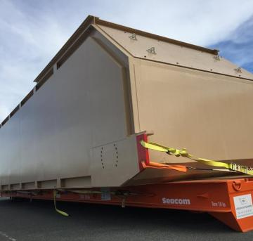 large beige container on doc being transported in Perth