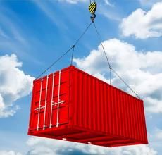 Red Container hanging from Crane used for international shipping